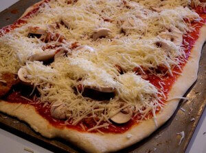 mushroom and sausage pizza with double cheese ready for the oven