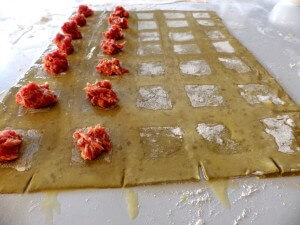 4 - ravioli sheet with egg wash saquares and sausage