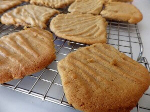 4 - peanut butter cookies cooling on the wire rack
