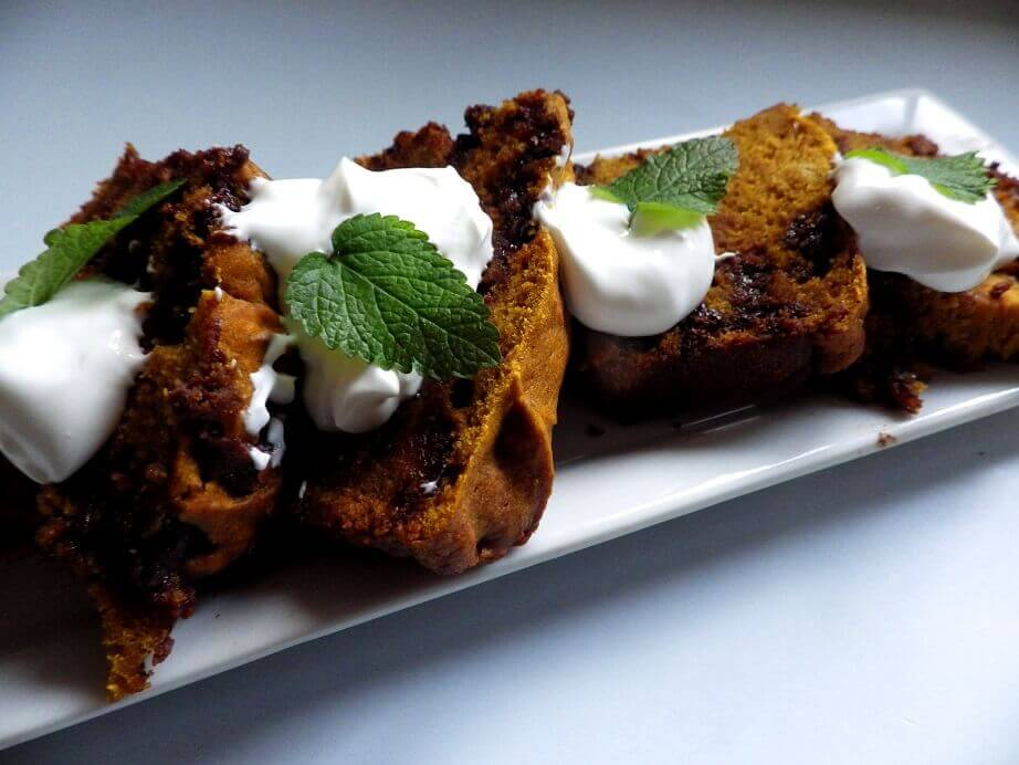 7 - sliced pumpkin chocoalte chip bread garnished with  sour cream and mint leaves