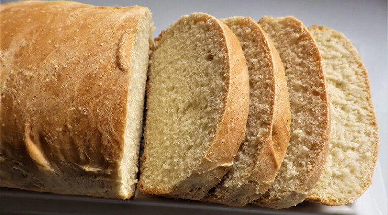 This recipe is for a traditional white bread that you bake in the bread  machine across the entire cycle. It makes a 1 1/2 pound loaf.